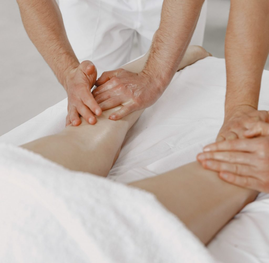 the-massage-with-four-hands-concept-of-healthcare-and-female-beauty-two-masseuses-make-double-massage-of-girl-woman-in-spa-salon-min
